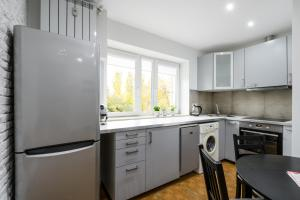 A kitchen or kitchenette at Local Apartment Muranów