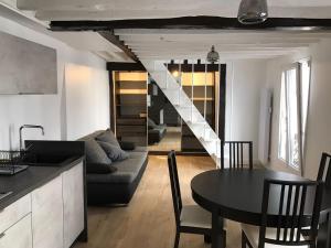 Sohvabaar või baar majutusasutuses Les Petits Carreaux
