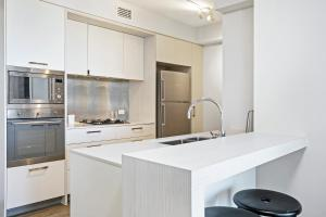 A kitchen or kitchenette at Arise Soda Apartments