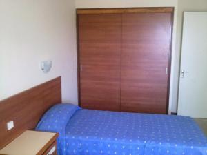 Een bed of bedden in een kamer bij Alsol Roca Verde