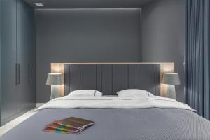 Łóżko lub łóżka w pokoju w obiekcie Apartment Baltiq