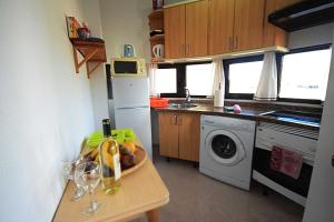 A kitchen or kitchenette at Maria's Apartments