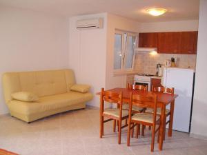 A kitchen or kitchenette at Vanda Seafront Studio