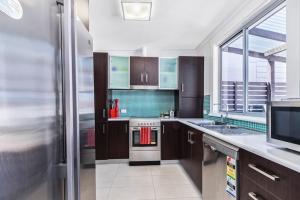 A kitchen or kitchenette at Ruby Soho Villas