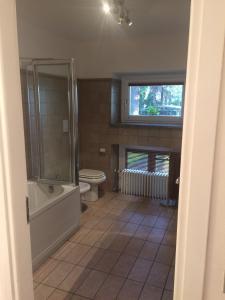 Ein Badezimmer in der Unterkunft Apartament Villa Conti Reina Como Lake