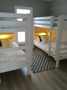 A bunk bed or bunk beds in a room at Villa Sandy