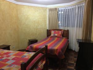 Una habitación en A la Altura de tus Sueños