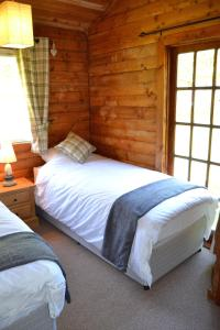 A bed or beds in a room at Grouse Lodge