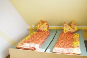 """Ein Bett oder Betten in einem Zimmer der Unterkunft Ferienwohnung """"Bergidyll"""""""