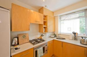 A kitchen or kitchenette at St Christopher's Place apartments