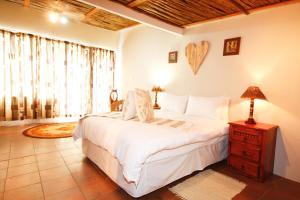 A bed or beds in a room at Botterkloof Resort