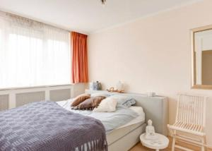 A bed or beds in a room at Beautiful Seaview Appartment at Scheveningen Beach!