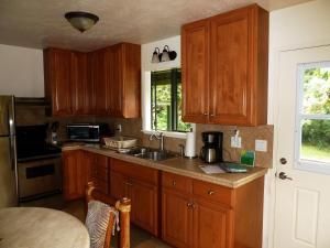 A kitchen or kitchenette at Hale Nanea - Hana Paradise Cottages
