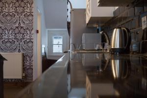 A kitchen or kitchenette at ArtHouse Boutique Apartment