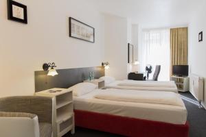 Кровать или кровати в номере Aparthotel VEGA