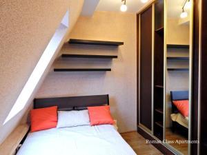 Poznań Class Apartments tesisinde bir odada yatak veya yataklar