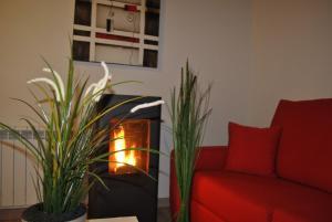A seating area at Apartamentos Spa Casco Historico de Isla