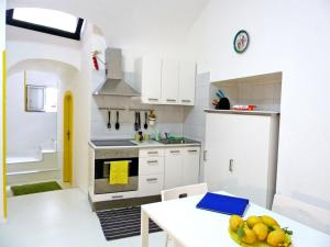 A kitchen or kitchenette at Sciù Sciù House