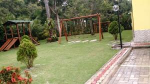 Children's play area at Apartamento Condomonio Antares