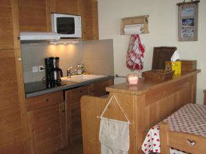 Η κουζίνα ή μικρή κουζίνα στο Appartement Le Chalet Des Rennes
