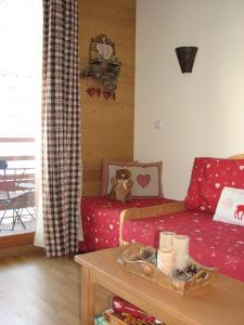 Ένα ή περισσότερα κρεβάτια σε δωμάτιο στο Appartement Le Chalet Des Rennes