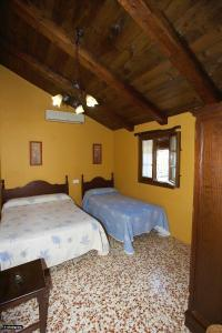 A bed or beds in a room at Casa del Huerto