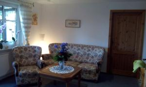 Ein Sitzbereich in der Unterkunft Ferienwohnung Sievers