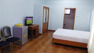 A television and/or entertainment centre at Majesty Residence
