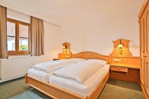 Ein Bett oder Betten in einem Zimmer der Unterkunft Appartementhaus Alpenpark
