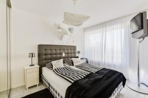 Ein Bett oder Betten in einem Zimmer der Unterkunft Casa Zando Beach Apartment