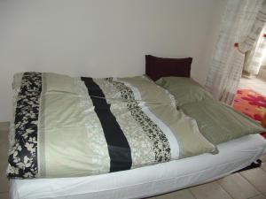 Un ou plusieurs lits dans un hébergement de l'établissement Apartment Natik