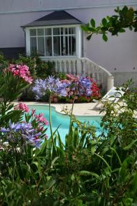 A view of the pool at La Maison rose or nearby