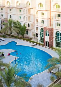 The swimming pool at or near Muscat Oasis Residences