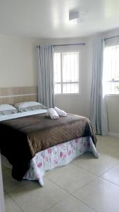 A bed or beds in a room at Casa Rejane