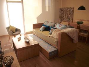 Una cama o camas en una habitación de Casa en San Martín de los Andes