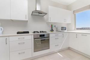 A kitchen or kitchenette at Royal Apartments Muizenberg