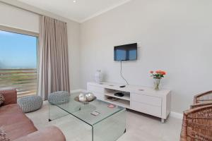 A television and/or entertainment center at Royal Apartments Muizenberg