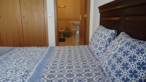 Cama ou camas em um quarto em Zé da Rita Apartment