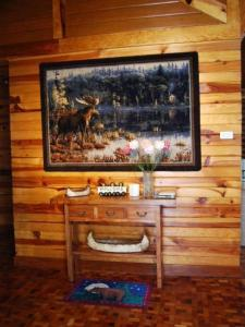 A television and/or entertainment center at Luxurious Baguio Log Cabin