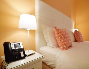 A bed or beds in a room at Rossio Apartments