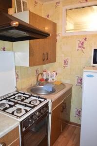Кухня или мини-кухня в Apartaments at Shevchenko 82
