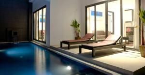 The swimming pool at or near Seastone Private Pool Villas