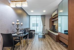 A seating area at Olive Bangkok Hotel