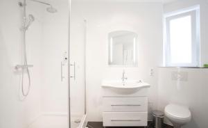 Ein Badezimmer in der Unterkunft Victoria Apartments
