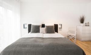 Victoria Apartmentsにあるベッド