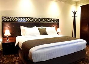 A bed or beds in a room at Procare Apart hotel