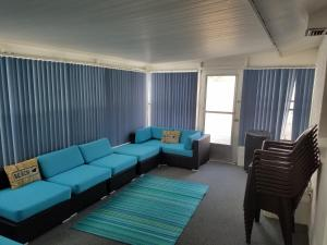 A seating area at Cute Bungalow near the Beach and River with Private Pool
