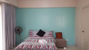 A bed or beds in a room at CC5H One Palm Tree Villas