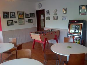 A restaurant or other place to eat at Clubhouse Gites