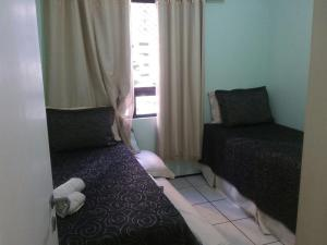 A bed or beds in a room at Apartamento Alta Vista
